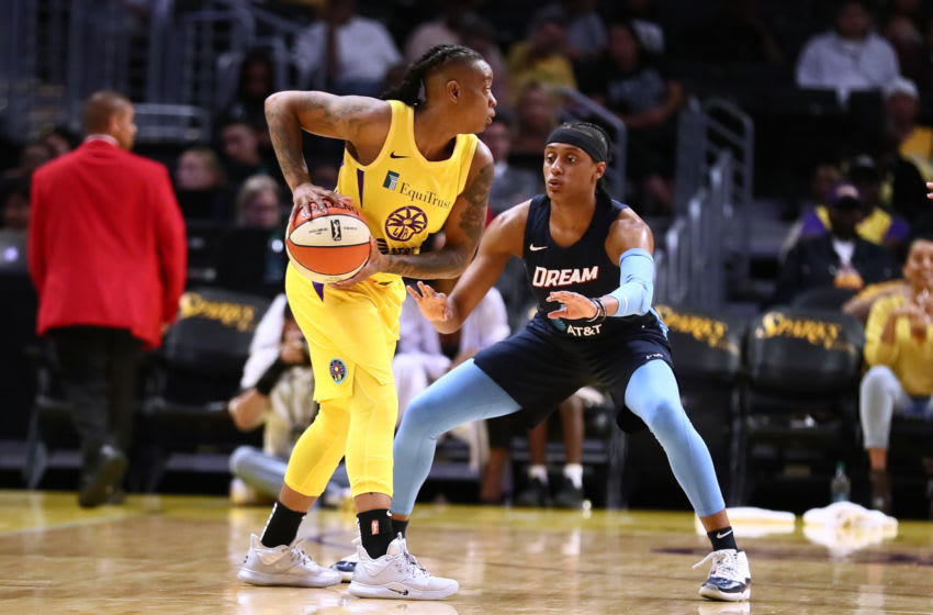 LOS ANGELES, CALIFORNIA - SEPTEMBER 03: Riquna Williams #2 of the Los Angeles Sparks handles the ball against Brittney Sykes #7 of the Atlanta Dream during a WNBA basketball game at Staples Center on September 03, 2019 in Los Angeles, California. NOTE TO USER: User expressly acknowledges and agrees that, by downloading and or using this photograph, User is consenting to the terms and conditions of the Getty Images License Agreement. (Photo by Leon Bennett/Getty Images)