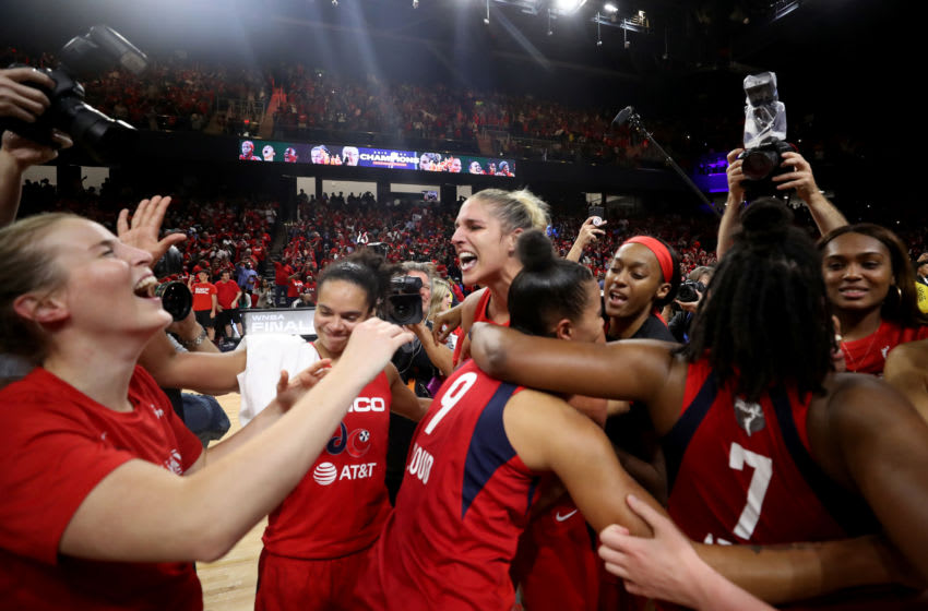 WASHINGTON, DC - OCTOBER 10: Elena Delle Donne #11 of the Washington Mystics celebrates with teammates after defeating the Connecticut Sun to win the 2019 WNBA Finals at St Elizabeths East Entertainment & Sports Arena on October 10, 2019 in Washington, DC. (Photo by Rob Carr/Getty Images)