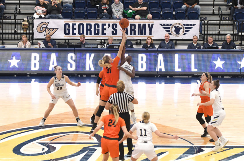 WASHINGTON, DC - NOVEMBER 10: Bella Alarie #31 of the Princeton Tigers and Essence Brown #32 of the George Washington Colonials tip off the ball during a women's basketball game at the Smith Center on November 102019 in Washington, DC. (Photo by Mitchell Layton/Getty Images)