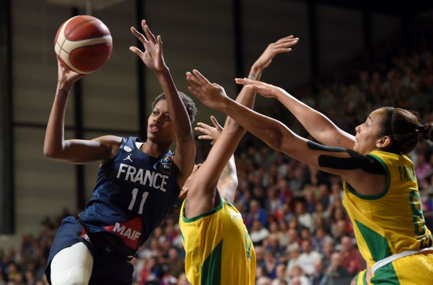France's wing Valeriane Vukosavljevic (L) fights for the ball with Brazilian's defender Taina Paixao (R) during the FIBA Women's Olympic Qualifying Tournament match between France and Brazil, on February 8, 2020, at the Prado stadium in Bourges, Center France. (Photo by GUILLAUME SOUVANT / AFP) (Photo by GUILLAUME SOUVANT/AFP via Getty Images)