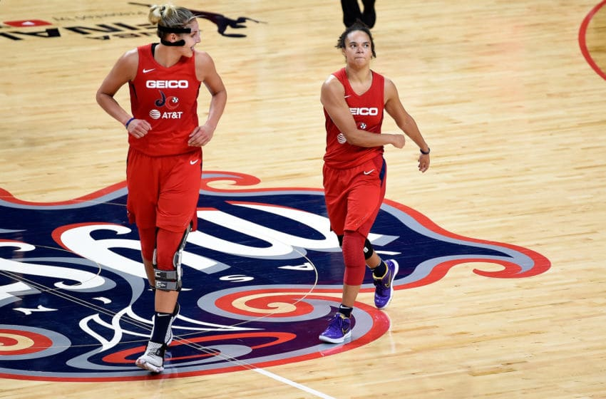WASHINGTON, DC - OCTOBER 10: Elena Delle Donne #11 of the Washington Mystics celebrates with Kristi Toliver #20 during Game 5 of the 2019 WNBA Finals against the Connecticut Sun at St Elizabeths East Entertainment & Sports Arena on October 10, 2019 in Washington, DC. (Photo by G Fiume/Getty Images)