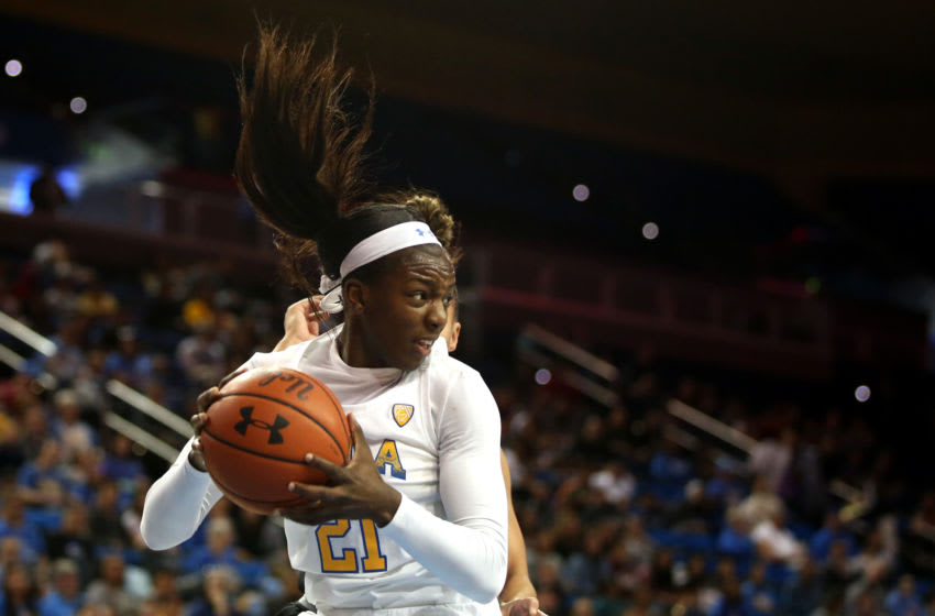 LOS ANGELES, CALIFORNIA - MARCH 01: Michaela Onyenwere #21 of the UCLA Bruins grabs a rebound during the first quarter against the Utah Utes at Pauley Pavilion on March 01, 2020 in Los Angeles, California. (Photo by Katharine Lotze/Getty Images)