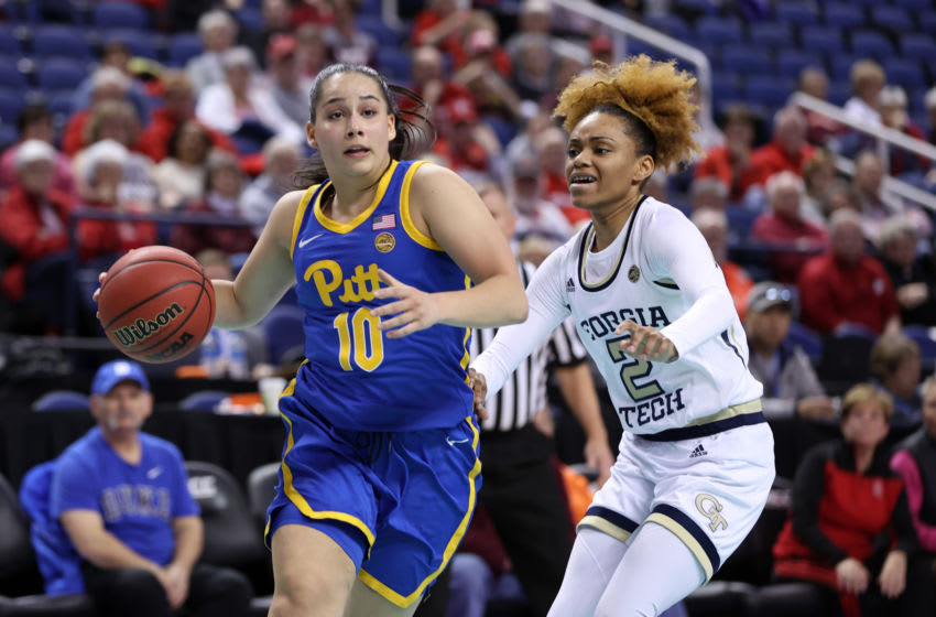 GREENSBORO, NC - MARCH 05: Ismini Prapa #10 of University of Pittsburgh drives past Jasmine Carson #2 of Georgia Tech during a game between Pitt and Georgia Tech at Greensboro Coliseum on March 05, 2020 in Greensboro, North Carolina. (Photo by Andy Mead/ISI Photos/Getty Images)
