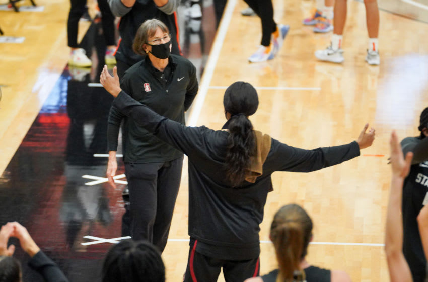 STOCKTON, CA - DECEMBER 15: Head coach Tara VanDerveer of the Stanford Cardinal is congratulated by her team after she sets the record for the most victories in Division I women's basketball, with 1,099 during a game between Stanford and Pacific at Alex G. Spanos Center on December 15, 2020 in Stockton, California.(Photo by John Todd/ISI Photos/Getty Images).