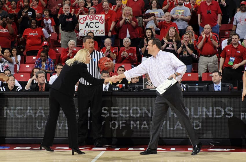 COLLEGE PARK, MD - MARCH 19: Head coach Brenda Frese of the Maryland Terrapins shakes hands with head coach Jeff Walz of the Louisville Cardinals in the second round of the NCAA women's basketball tournament at the Comcast Center on March 19, 2012 in College Park, Maryland. (Photo by G Fiume/Maryland Terrapins/Getty Images)