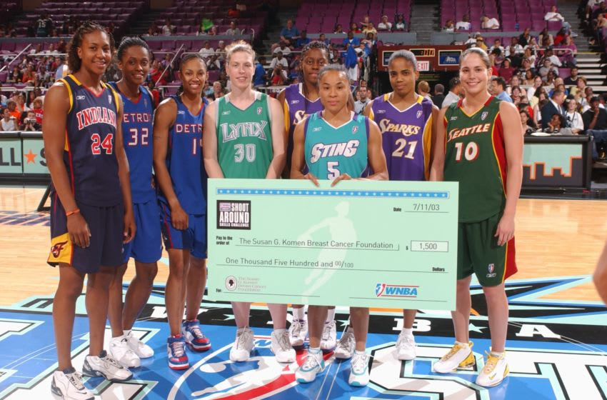 NEW YORK - JULY 11: Tamika Catchings, Swin Cash, Deanna Nolan, Katie Smith, Nikki Teasley, Dawn Staley, Tamecka Dixon and Sue Bird poses with the check for the Susan G. Komen Breast Cancer Foundation at the 2003 WNBA All-Star Skills Competition on July 11, 2003 at Madison Square Garden in New York City. NOTE TO USER: User expressly acknowledges and agrees that, by downloading and/or using this Photograph, User is consenting to the terms and conditions of the Getty Images License Agreement. (Photo by Nathaniel S. Butler/WNBAE via Getty Images)