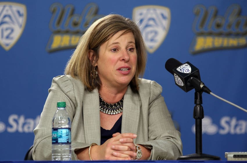 LOS ANGELES, CA - DECEMBER 30: Head coach Cori Close of the UCLA Bruins speaks to the media during the post-game press conference after the game against the USC Trojans at Pauley Pavilion on December 30, 2013 in Los Angeles, California. (Photo by Jeff Golden/Getty Images)