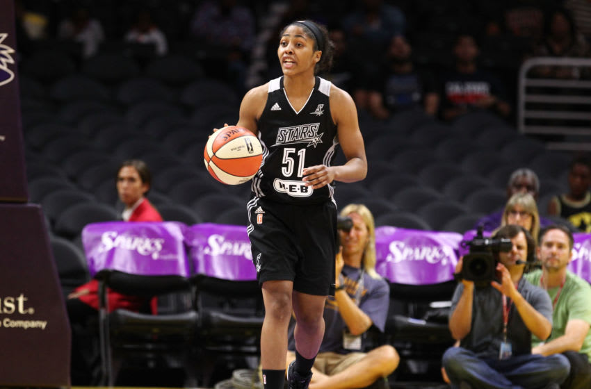 LOS ANGELES, CA - JULY 02: Sydney Colson #51 of the San Antonio Stars brings ball up the court against the Los Angeles Sparks in a WNBA game at Staples Center on July 2, 2015 in Los Angeles, California. (Photo by Leon Bennett/Getty Images)