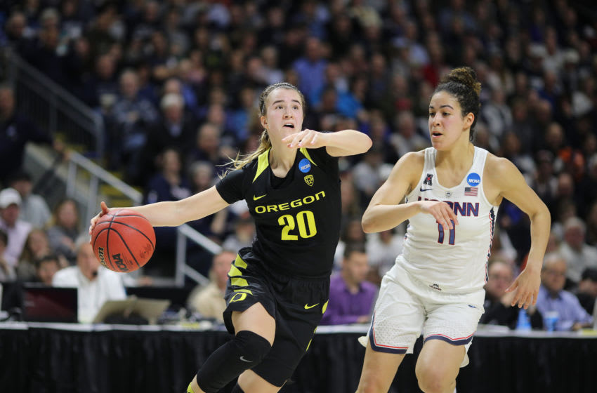 BRIDGEPORT, CONNECTICUT- MARCH 25: Sabrina Ionescu #20 of the Oregon Ducks drives to the basket defended by Kia Nurse #11 of the Connecticut Huskies during the UConn Huskies Vs Oregon Ducks, NCAA Women's Division 1 Basketball Championship game on March 27th, 2017 at the Webster Bank Arena, Bridgeport, Connecticut. (Photo by Tim Clayton/Corbis via Getty Images)