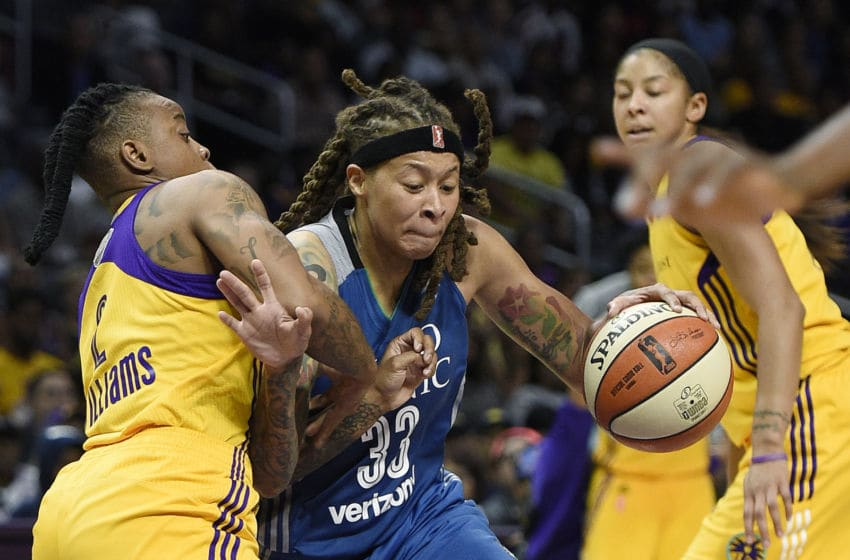 LOS ANGELES, CA - OCTOBER 1: Seimone Augustus #33 of the Minnesota Lynx is defended by Riquna Williams #2 of the Los Angeles Sparks during the second half of Game Four of WNBA Finals at Staples Center October 1, 2017, in Los Angeles, California. NOTE TO USER: User expressly acknowledges and agrees that, by downloading and/or using this photograph, user is consenting to the terms and conditions of the Getty Images License Agreement. (Photo by Kevork Djansezian/Getty Images)