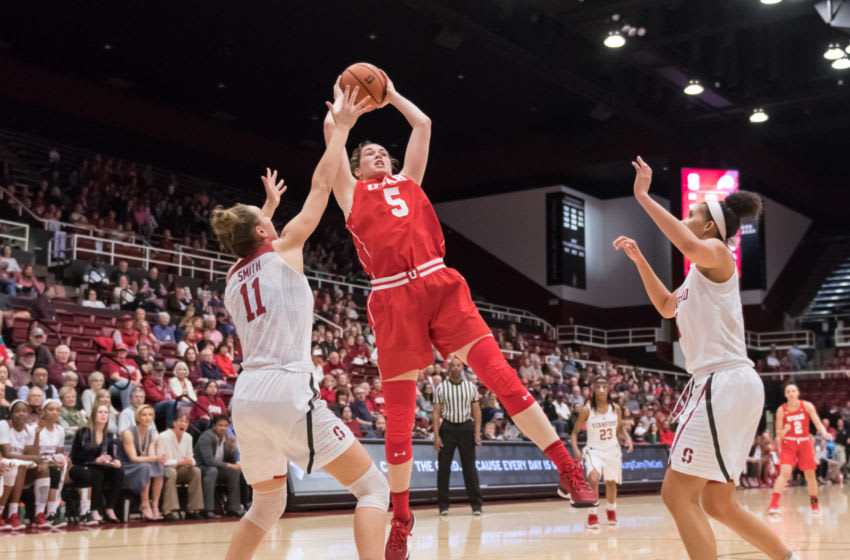 PALO ALTO, CA - FEBRUARY 09: Utah Utes center Megan Huff (5) grabs a rebound between Stanford Cardinals forward Alanna Smith (11) and Stanford Cardinals forward Kaylee Johnson (5) during the game between the Utah Utes and the Stanford Cardinals on Friday, February 9, 2018 at Maples Pavilion in Palo Alto, CA. (Photo by Douglas Stringer/Icon Sportswire via Getty Images)
