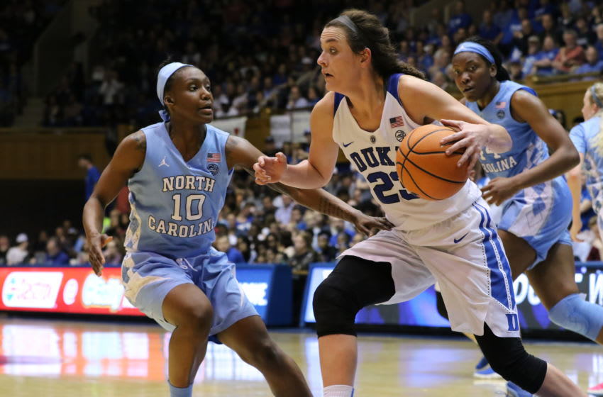 DURHAM, NC - FEBRUARY 25: Duke Blue Devils guard Rebecca Greenwell (23) with the ball and North Carolina Tar Heels guard Jamie Cherry (10) during the 2nd half of the Women's Duke Blue Devils game versus the Women's North Carolina Tar Heels on February 25, 2018, at Cameron Indoor Stadium in Durham, NC. (Photo by Jaylynn Nash/Icon Sportswire via Getty Images)