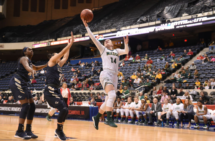 RICHMOND, VA - MARCH 02: Nicole Cardano-Hillary #14 of the George Mason Patriots drives to the basket the quarterfinal round of the Atlantic-10 Women's Basketball Tournament against the George Washington Colonials at Richmond Coliseum on March 2, 2018 in Richmond, Virginia. The Colonials won 64-59. Photo by Mitchell Layton/Getty Images)