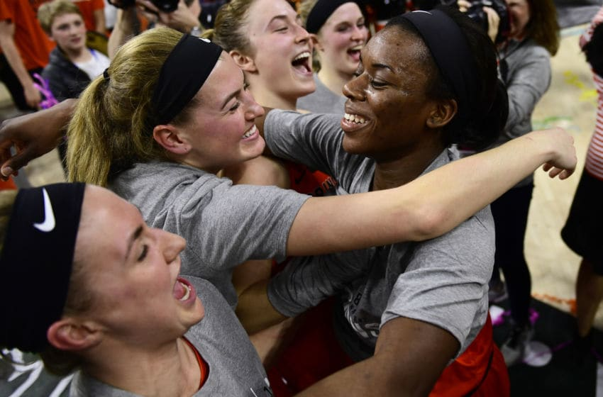 PHILADELPHIA, PA - MARCH 11: Tia Weledji #32 (C) hugs teammate Taylor Baur #22 of the Princeton Tigers after the win at The Palestra on March 11, 2018 in Philadelphia, Pennsylvania. Princeton defeated Penn 63-34. (Photo by Corey Perrine/Getty Images)