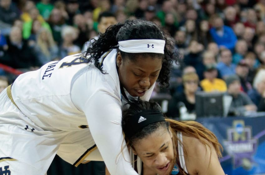 SPOKANE, WA - MARCH 24: Arike Ogunbowale #24 of the Notre Dame Fighting Irish and Chennedy Carter #3 of the Texas A&M Aggies battle for possession of the ball during the 2018 NCAA Division 1 Women's Basketball Tournament at Spokane Veterans Memorial Arena on March 24, 2018 in Spokane, Washington. (Photo by William Mancebo/Getty Images)