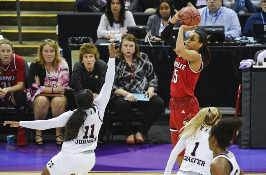 COLUMBUS, OH - MARCH 30: Asia Durr #25 of the Louisville Cardinals attempts a three point basket over Roshunda Johnson #11 of the Mississippi State Bulldogs during a semifinal game of the 2018 Division I Women's Basketball Final Four at Nationwide Arena in Columbus, Ohio. (Tim Nwachukwu/NCAA Photos via Getty Images)