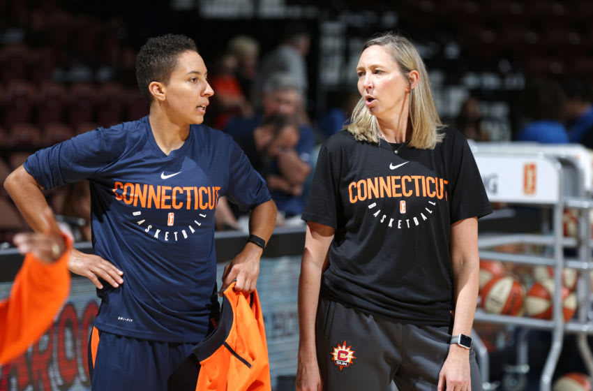 UNCASVILLE, CT - JULY 11: Layshia Clarendon #23 and Assistant Coach Brandi Poole of the Connecticut Sun speak before the game against the New York Liberty on July 11, 2018 at the Mohegan Sun Arena in Uncasville, Connecticut. NOTE TO USER: User expressly acknowledges and agrees that, by downloading and/or using this photograph, user is consenting to the terms and conditions of the Getty Images License Agreement. Mandatory Copyright Notice: Copyright 2018 NBAE (Photo by Chris Marion/NBAE via Getty Images)