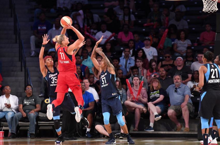 ATLANTA, GA - JULY 15: Elena Delle Donne #11 of the Washington Mystics shoots the ball against Jessica Breland #51 of the Atlanta Dream and Angel McCoughtry #35 of the Atlanta Dream on July 15, 2018 at Hank McCamish Pavilion in Atlanta, Georgia. NOTE TO USER: User expressly acknowledges and agrees that, by downloading and/or using this Photograph, user is consenting to the terms and conditions of the Getty Images License Agreement. Mandatory Copyright Notice: Copyright 2018 NBAE (Photo by Scott Cunningham/NBAE via Getty Images)