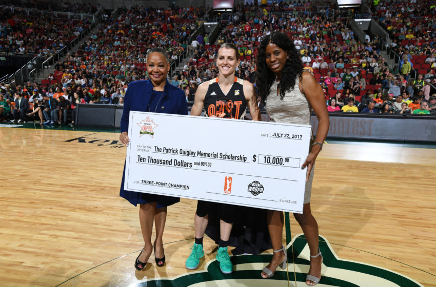 SEATTLE, WA - JULY 22: WNBA President Lisa Borders presents a check to Allie Quigley
