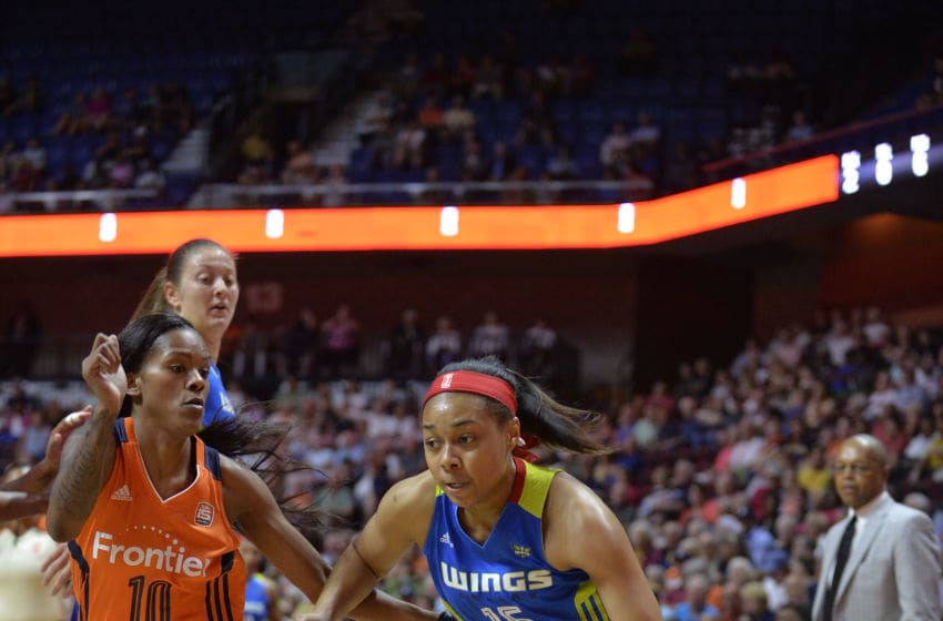 UNCASVILLE, CT - AUGUST 23: Dallas Wings Guard Allisha Gray (15) drives to the basket as Connecticut Sun Guard Courtney Williams (10) defends during the game as the Connecticut Sun host the Dallas Wings on August 23, 2017 at the Mohegan Sun Arena in Uncasville, Connecticut. (Photo by Williams Paul/Icon Sportswire via Getty Images)