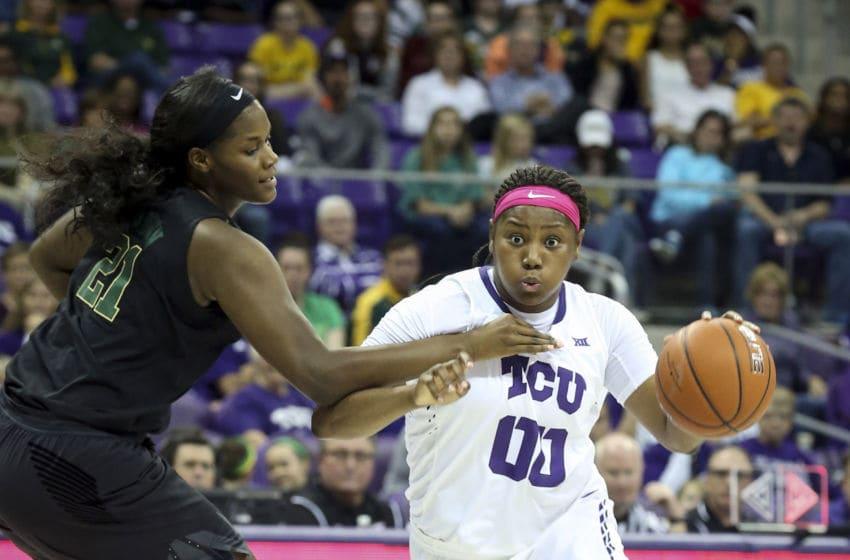 Baylor's Kalani Brown (21) fouls TCU's Amy Okonkwo (00) on Sunday, Feb. 12, 2017 at Schollmaier Arena in Fort Worth, Texas. (Richard W. Rodriguez/Fort Worth Star-Telegram/TNS via Getty Images)