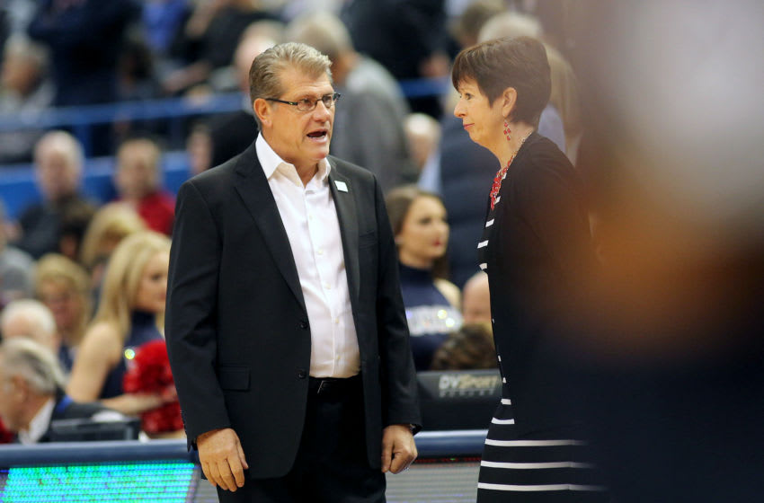 HARTFORD, CONNECTICUT- DECEMBER 03: Head coach Geno Auriemma of the Connecticut Huskies and head coach Muffet McGraw of the Notre Dame Fighting Irish greet each other before the the UConn Huskies Vs Notre Dame, NCAA Women's Basketball game at the XL Center, Hartford, Connecticut. December 3, 2017 (Photo by Tim Clayton/Corbis via Getty Images)