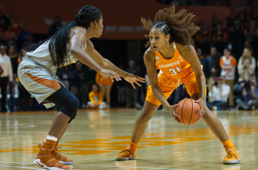 KNOXVILLE, TN - DECEMBER 10: Tennessee Lady Volunteers guard/forward Jaime Nared (31) being guarded by Texas Longhorns guard Ariel Atkins (23) during a game between the Texas Longhorns and Tennessee Lady Volunteers on December 10, 2017, at Thompson-Boling Arena in Knoxville, TN. Tennessee defeated Texas 82-75.(Photo by Bryan Lynn/Icon Sportswire via Getty Images)