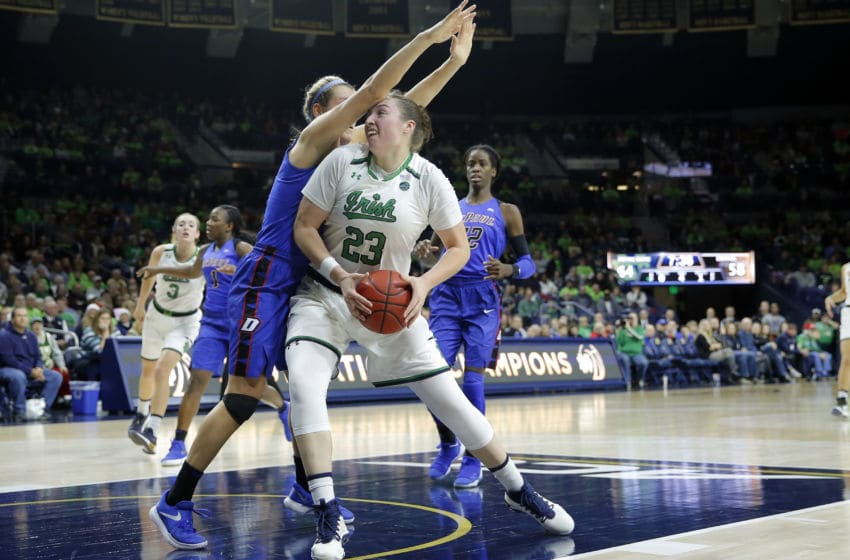 SOUTH BEND, IN - DECEMBER 17: Notre Dame Fighting Irish forward Jessica Shepard (23) drives into DePaul Blue Demons guard Kelly Campbell (20) during the game between the DePaul Blue Demons and Notre Dame Fighting Irish on December 17, 2017, at Purcell Pavilion in South Bend, IN. The Notre Dame Fighting Irish defeated the DePaul Blue Demons 91-82. (Photo by Jeffrey Brown/Icon Sportswire via Getty Images)