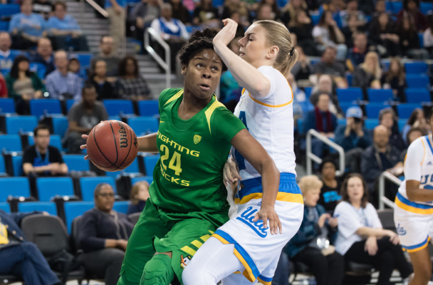 LOS ANGELES, CA - JANUARY 15: Oregon Ducks forward Ruthy Hebard (24) drives the ball to the net with UCLA Bruins forward Paulina Hersler (24) defending during the game between the Oregon Ducks and the UCLA Bruins on January 15, 2017, at Pauley Pavilion in Los Angeles, CA. (Photo by David Dennis/Icon Sportswire via Getty Images)