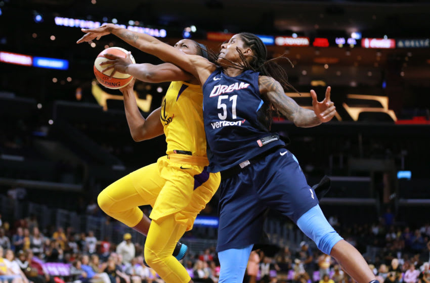 LOS ANGELES, CA - JUNE 12: Chelsea Gray #12 of the Los Angeles Sparks handles the ball against Jessica Breland #51 of the Atlanta Dream during a WNBA basketball game at Staples Center on June 12, 2018 in Los Angeles, California. (Photo by Leon Bennett/Getty Images)