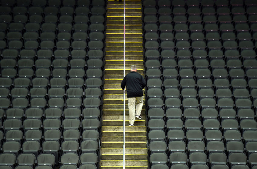 KANSAS CITY, MISSOURI - MARCH 12: A lone fan exits Sprint Center after it was announced that the Big 12 basketball tournament had been cancelled due to growing concerns with the Coronavirus (COVID-19) outbreak on March 12, 2020 in Kansas City, Missouri. (Photo by Ed Zurga/Getty Images)