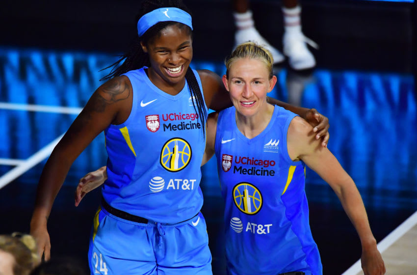 PALMETTO, FLORIDA - AUGUST 12: Ruthy Hebard #24 and Courtney Vandersloot #22 of the Chicago Sky embrace after defeating the Phoenix Mercury 89-71 at Feld Entertainment Center on August 12, 2020 in Palmetto, Florida. NOTE TO USER: User expressly acknowledges and agrees that, by downloading and or using this photograph, User is consenting to the terms and conditions of the Getty Images License Agreement. (Photo by Julio Aguilar/Getty Images)