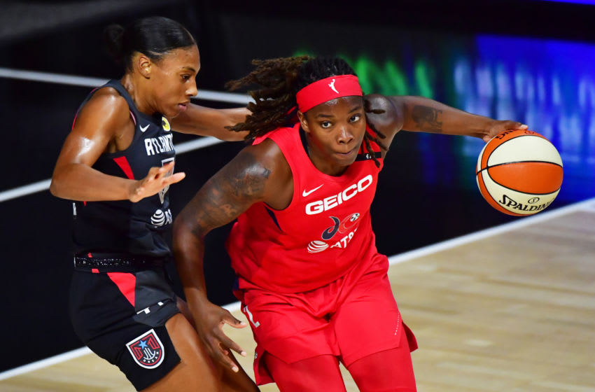 PALMETTO, FLORIDA - AUGUST 19: Myisha Hines-Allen #2 of the Washington Mystics looks to dribble around Betnijah Laney #44 of the Atlanta Dream during the first half of a game at Feld Entertainment Center on August 19, 2020 in Palmetto, Florida. NOTE TO USER: User expressly acknowledges and agrees that, by downloading and or using this photograph, User is consenting to the terms and conditions of the Getty Images License Agreement. (Photo by Julio Aguilar/Getty Images)
