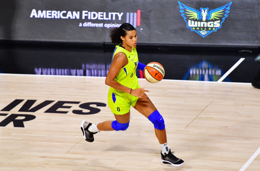 PALMETTO, FLORIDA - SEPTEMBER 09: Satou Sabally #0 of the Dallas Wings dribbles during the second half against the Seattle Storm at Feld Entertainment Center on September 09, 2020 in Palmetto, Florida. NOTE TO USER: User expressly acknowledges and agrees that, by downloading and or using this photograph, User is consenting to the terms and conditions of the Getty Images License Agreement. (Photo by Julio Aguilar/Getty Images)