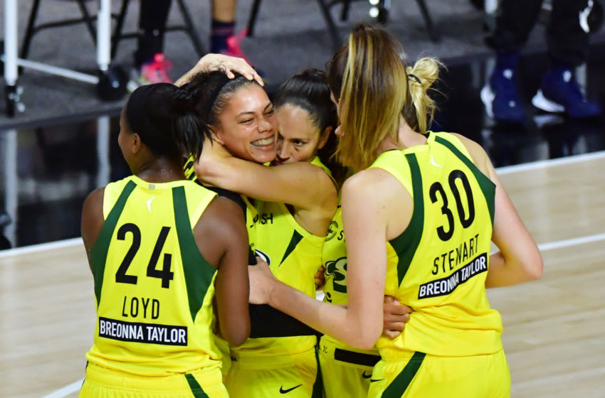 PALMETTO, FLORIDA - SEPTEMBER 22: Alysha Clark #32 of the Seattle Storm is surrounded by teammates after a buzzer beater to defeat the Minnesota Lynx 88-86 following Game One of their Third Round playoff at Feld Entertainment Center on September 22, 2020 in Palmetto, Florida. NOTE TO USER: User expressly acknowledges and agrees that, by downloading and or using this photograph, User is consenting to the terms and conditions of the Getty Images License Agreement. (Photo by Julio Aguilar/Getty Images)