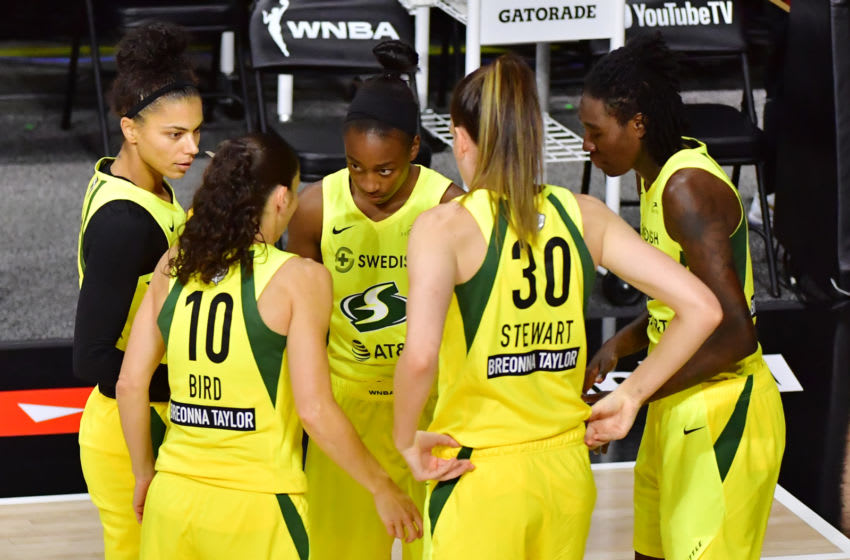 PALMETTO, FLORIDA - OCTOBER 02: Alysha Clark #32, Sue Bird #10, Jewell Loyd #24, Breanna Stewart #30, and Natasha Howard #6 of the Seattle Storm meet prior to tip off of Game 1 of the WNBA Finals against the Las Vegas Aces at Feld Entertainment Center on October 02, 2020 in Palmetto, Florida. NOTE TO USER: User expressly acknowledges and agrees that, by downloading and or using this photograph, User is consenting to the terms and conditions of the Getty Images License Agreement. (Photo by Julio Aguilar/Getty Images)