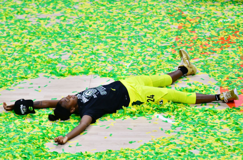 PALMETTO, FLORIDA - OCTOBER 06: Jewell Loyd #24 of the Seattle Storm does a confetti angel on the court after defeating the Las Vegas Aces 92-59 following Game 3 of the WNBA Finals to win the Championship at Feld Entertainment Center on October 06, 2020 in Palmetto, Florida. NOTE TO USER: User expressly acknowledges and agrees that, by downloading and or using this photograph, User is consenting to the terms and conditions of the Getty Images License Agreement. (Photo by Julio Aguilar/Getty Images)