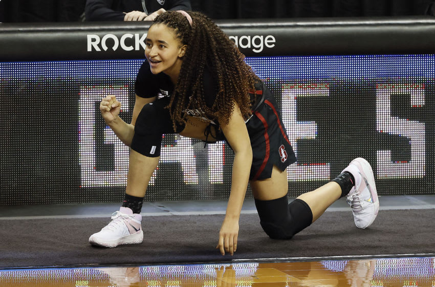 EUGENE, OREGON - FEBRUARY 15: Haley Jones #30 of the Stanford Cardinal cheers for her team as she waits to enter the game against the Oregon Ducks during the second half at Matthew Knight Arena on February 15, 2021 in Eugene, Oregon. (Photo by Soobum Im/Getty Images)