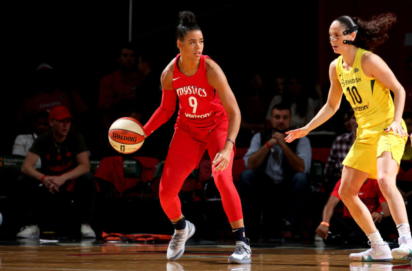 FAIRFAX, VA - SEPTEMBER 12: Natasha Cloud #9 of the Washington Mystics handles the ball against the Seattle Storm during Game Three of the 2018 WNBA Finals on September 12, 2018 at Eaglebank Arena at George Mason University in Fairfax, VA. NOTE TO USER: User expressly acknowledges and agrees that, by downloading and or using this photograph, User is consenting to the terms and conditions of the Getty Images License Agreement. Mandatory Copyright Notice: Copyright 2018 NBAE (Photo by Ned Dishman/NBAE via Getty Images)
