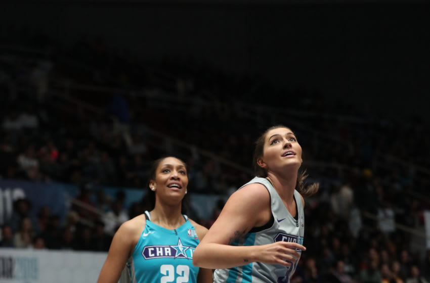 CHARLOTTE, NC - FEBRUARY 15: WNBA player Aja Wilson #22 rebounds against WNBA player Stefanie Dolson #31 during the 2019 NBA All-Star Celebrity Game on February 15, 2019 at Bojangles Coliseum in Charlotte, North Carolina. NOTE TO USER: User expressly acknowledges and agrees that, by downloading and or using this photograph, User is consenting to the terms and conditions of the Getty Images License Agreement. Mandatory Copyright Notice: Copyright 2019 NBAE (Photo by Joe Murphy/NBAE via Getty Images)