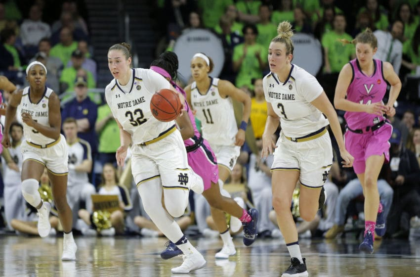 SOUTH BEND, IN - MARCH 03: Notre Dame Fight Irish forward Jessica Shepard (32) drives the ball up court during the game between Virginia Cavilers and the Notre Dame Fighting Irish on March 03, 2019, at Purcell Pavilion in South Bend, IN. (Photo by Jeffrey Brown/Icon Sportswire via Getty Images)