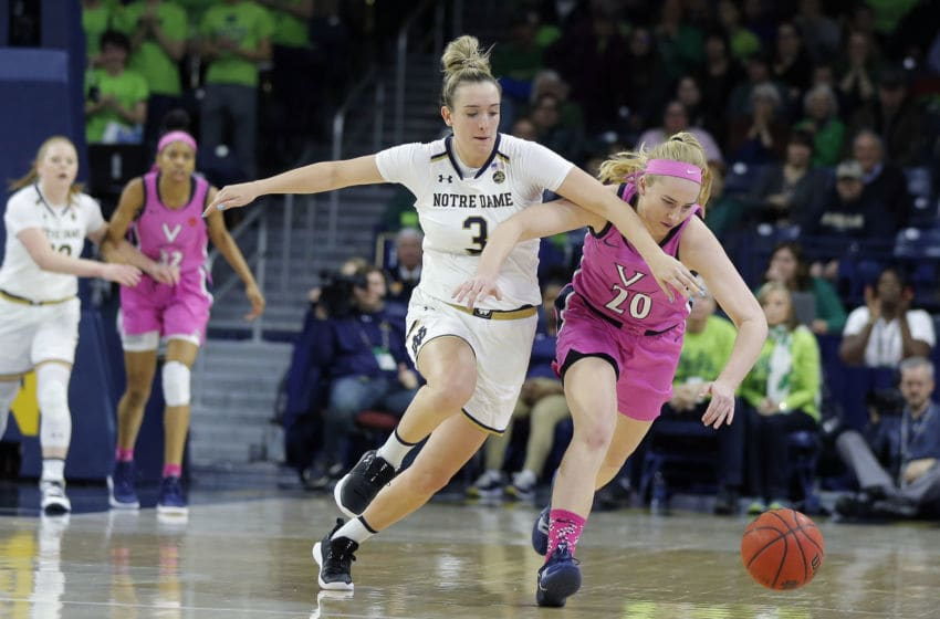 SOUTH BEND, IN - MARCH 03: Virginia Cavaliers guard Erica Martinsen (20) battles with Notre Dame Fight Irish guard Marina Mabrey (3) for the loose ball during the game between Virginia Cavilers and the Notre Dame Fighting Irish on March 03, 2019, at Purcell Pavilion in South Bend, IN. (Photo by Jeffrey Brown/Icon Sportswire via Getty Images)