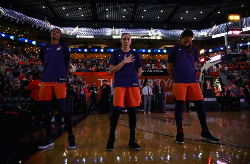 PHOENIX, AZ - AUGUST 31: (L-R) DeWanna Bonner #24, Diana Taurasi #3 and Brittney Griner #42 of the Phoenix Mercury stand attended for the national anthem before game three of the WNBA Western Conference Finals against the Seattle Storm at Talking Stick Resort Arena on August 31, 2018 in Phoenix, Arizona. NOTE TO USER: User expressly acknowledges and agrees that, by downloading and or using this photograph, User is consenting to the terms and conditions of the Getty Images License Agreement. (Photo by Christian Petersen/Getty Images)