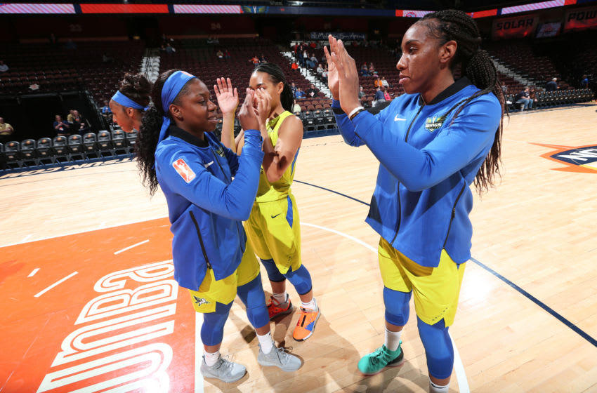 UNCASVILLE, CT - MAY 13: Arike Ogunbowale #24 of The Dallas Wings and Kayla Thornton #6 of The Dallas Wings high-five prior to a game against the Atlanta Dream on May 13, 2019 at the Mohegan Sun Arena in Uncasville, Connecticut. NOTE TO USER: User expressly acknowledges and agrees that, by downloading and or using this photograph, User is consenting to the terms and conditions of the Getty Images License Agreement. Mandatory Copyright Notice: Copyright 2019 NBAE (Photo by Ned Dishman/NBAE via Getty Images)