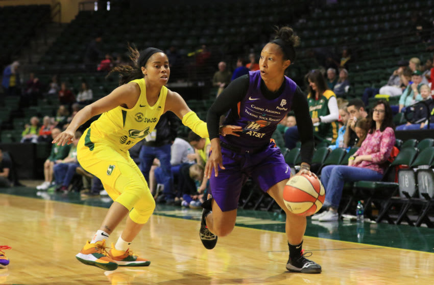 EVERETT, WA- MAY 15: Briann January #12 of the Phoenix Mercury handles the ball against the Seattle Storm on May 15, 2019 at the Angel of the Winds Arena, in Everett, Washington. NOTE TO USER: User expressly acknowledges and agrees that, by downloading and or using this photograph, User is consenting to the terms and conditions of the Getty Images License Agreement. Mandatory Copyright Notice: Copyright 2019 NBAE (Photo by Joshua Huston/NBAE via Getty Images)