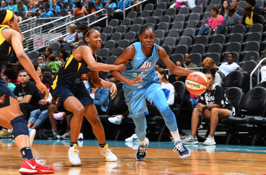 ATLANTA, GA - JUNE 19: Tiffany Hayes #15 of the Atlanta Dream handles the ball against the Indiana Fever on June 19, 2019 at the State Farm Arena in Atlanta, Georgia. NOTE TO USER: User expressly acknowledges and agrees that, by downloading and or using this photograph, User is consenting to the terms and conditions of the Getty Images License Agreement. Mandatory Copyright Notice: Copyright 2019 NBAE (Photo by Scott Cunningham/NBAE via Getty Images)