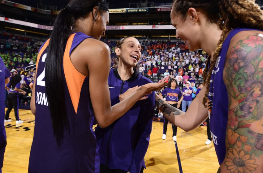 PHOENIX, AZ- JULY 14: DeWanna Bonner #24, Diana Taurasi #3, and Brittney Griner #42 of Phoenix Mercury smile after a game against the Dallas Wings on July 14, 2019 at the Talking Stick Resort Arena, in Phoenix, Arizona. NOTE TO USER: User expressly acknowledges and agrees that, by downloading and or using this photograph, User is consenting to the terms and conditions of the Getty Images License Agreement. Mandatory Copyright Notice: Copyright 2019 NBAE (Photo by Barry Gossage/NBAE via Getty Images)