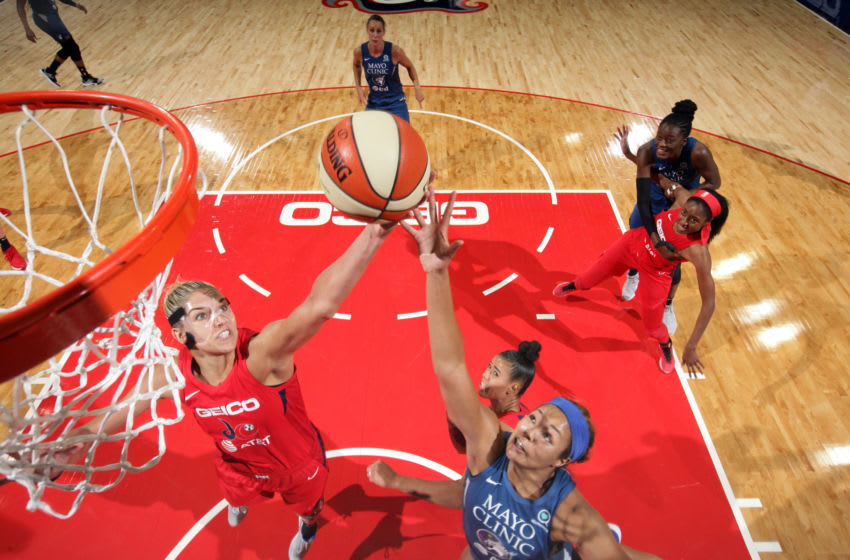 WASHINGTON, DC - AUGUST 11: Elena Delle Donne #11 of the Washington Mystics and Napheesa Collier #24 of the Minnesota Lynx reach for the ball during the game on August 11, 2019 at the St. Elizabeths East Entertainment and Sports Arena in Washington, DC. NOTE TO USER: User expressly acknowledges and agrees that, by downloading and or using this photograph, User is consenting to the terms and conditions of the Getty Images License Agreement. Mandatory Copyright Notice: Copyright 2019 NBAE (Photo by Ned Dishman/NBAE via Getty Images)