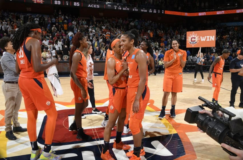 UNCASVILLE, CT - AUGUST 23: Jasmine Thomas #5 of the Connecticut Sun and Alyssa Thomas #25 of the Connecticut Sun embrace following he game against the Las Vegas Aces on August 23, 2019 at the Mohegan Sun Arena in Uncasville, Connecticut. NOTE TO USER: User expressly acknowledges and agrees that, by downloading and or using this photograph, User is consenting to the terms and conditions of the Getty Images License Agreement. Mandatory Copyright Notice: Copyright 2019 NBAE (Photo by Brian Babineau/NBAE via Getty Images)