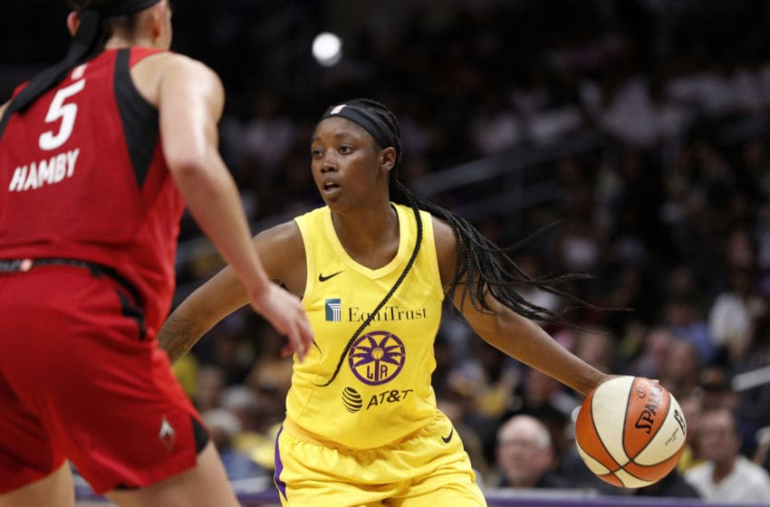 LOS ANGELES, CALIFORNIA - AUGUST 01: Guard Alexis Jones #1 of the Los Angeles Sparks handles the ball defended by forward Dearica Hamby #5 of the Las Vegas Aces at Staples Center on August 01, 2019 in Los Angeles, California. NOTE TO USER: User expressly acknowledges and agrees that, by downloading and or using this photograph, User is consenting to the terms and conditions of the Getty Images License Agreement. (Photo by Meg Oliphant/Getty Images)